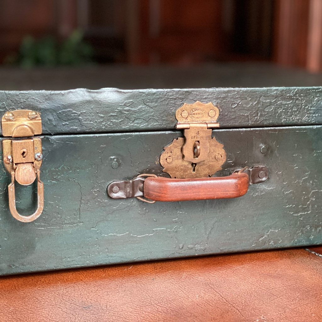 little green suitcase